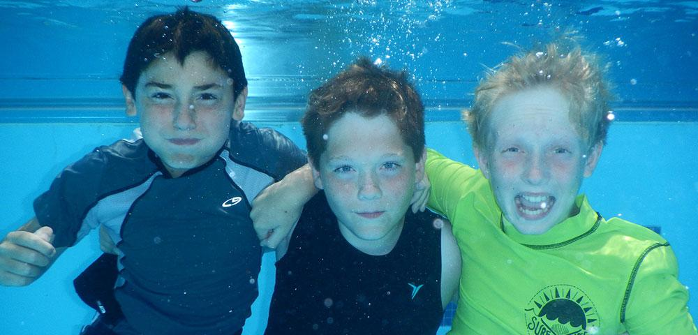 Boys swimming underwater